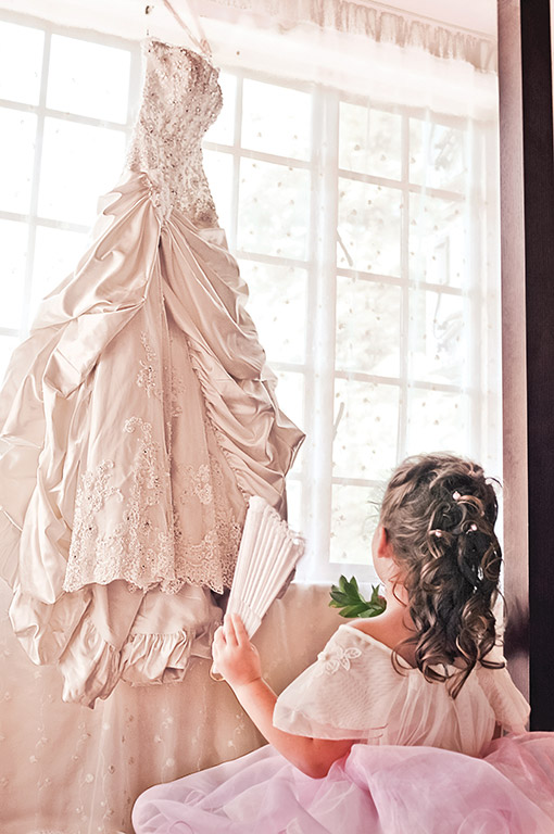 Photograph of bride dress and flower girl