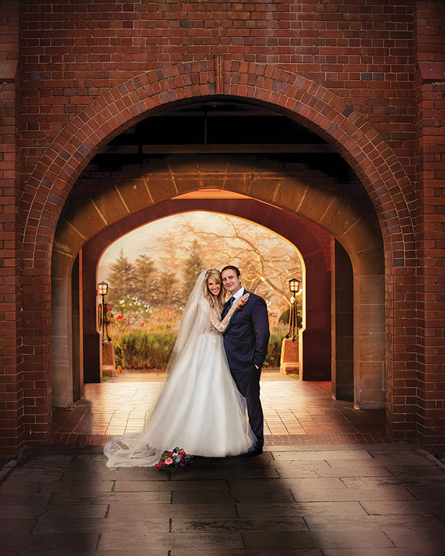 Garden Route Wedding Photograph of bride and groom under arch