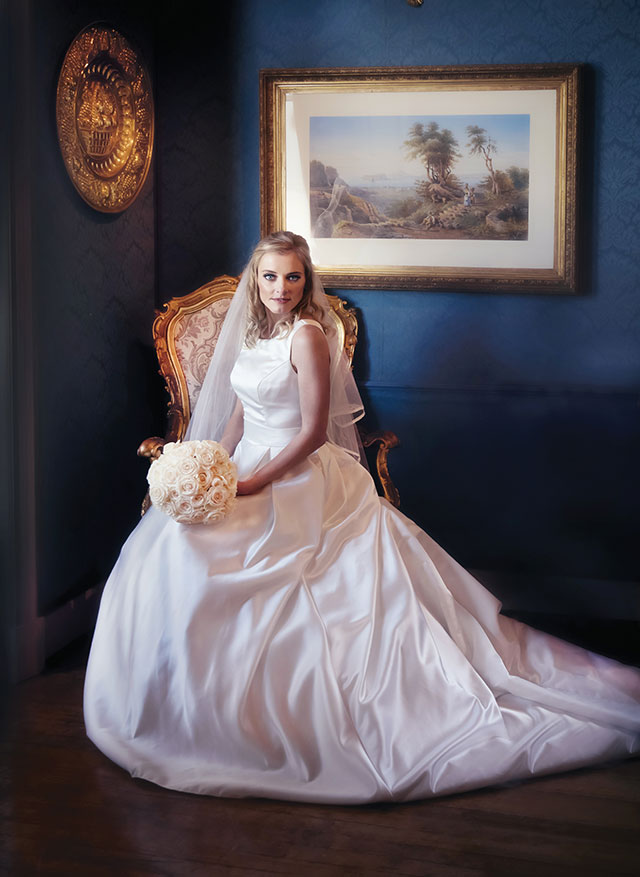 Garden Route Wedding Photograph of bride sitting on antique chair