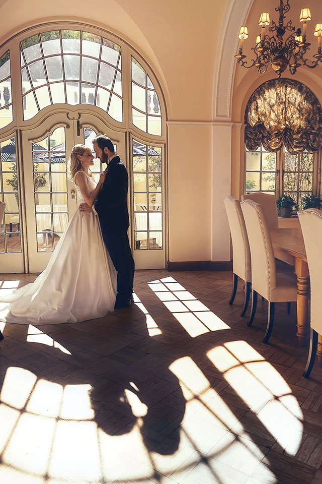 Wedding Photograph of couple standing in beautiful setting