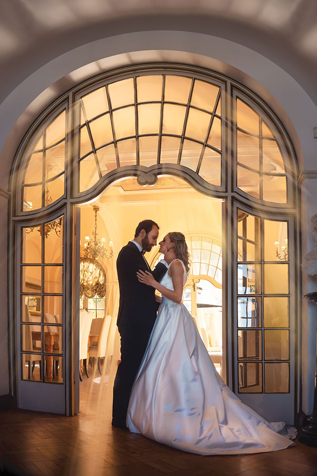 Garden Route Wedding Photograph of bride and groom under beautiful arch