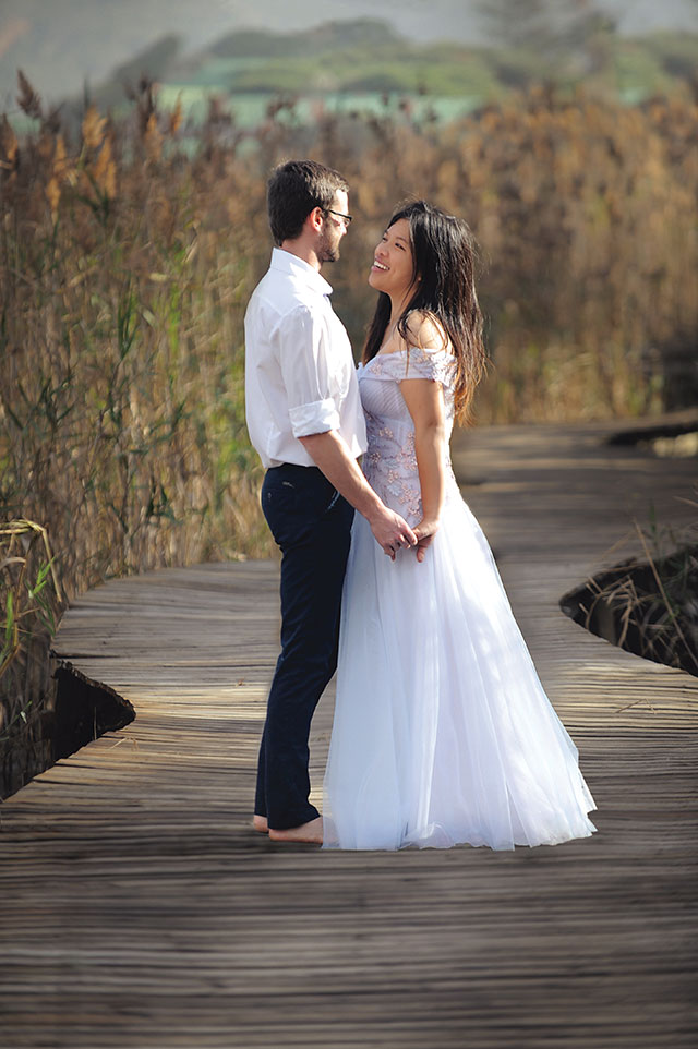 Wedding Photograph of couple on wooden bridge