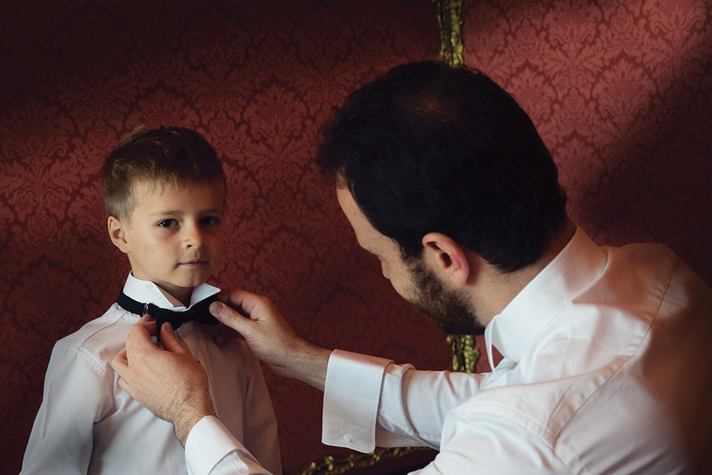 picture of wedding groom with page boy
