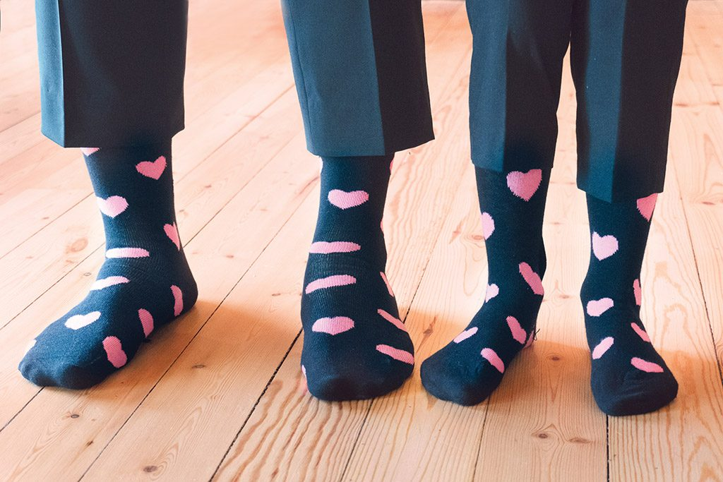 picture of wedding groom with page boy wearing special socks