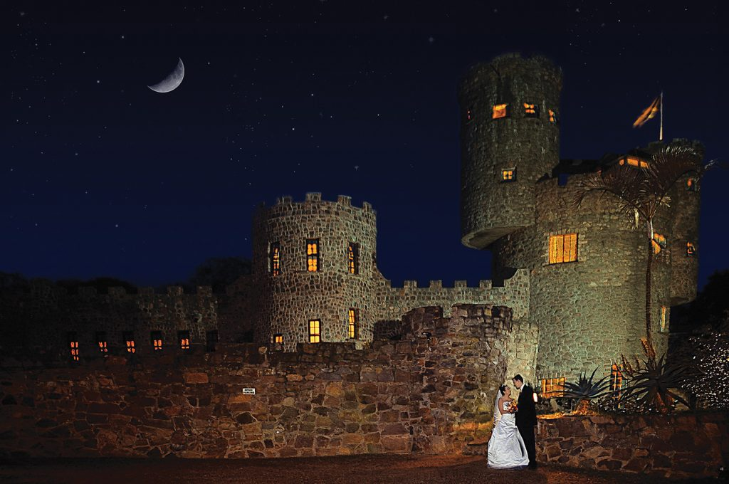 romantic wedding photo of couple outside an old castle