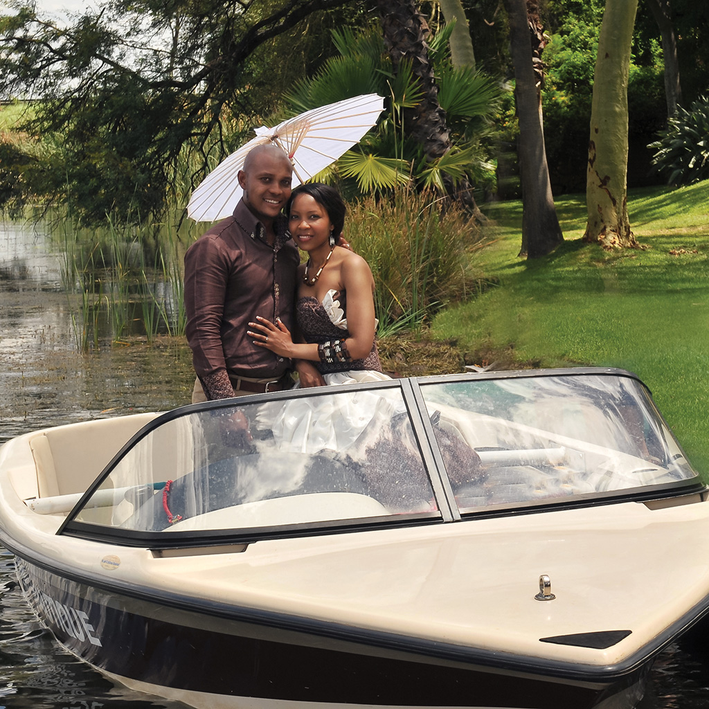 Wedding photo of couple on a boat