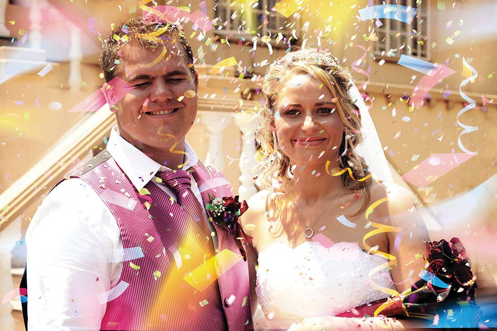 Wedding Photograph of Confetti and Newly Married couple