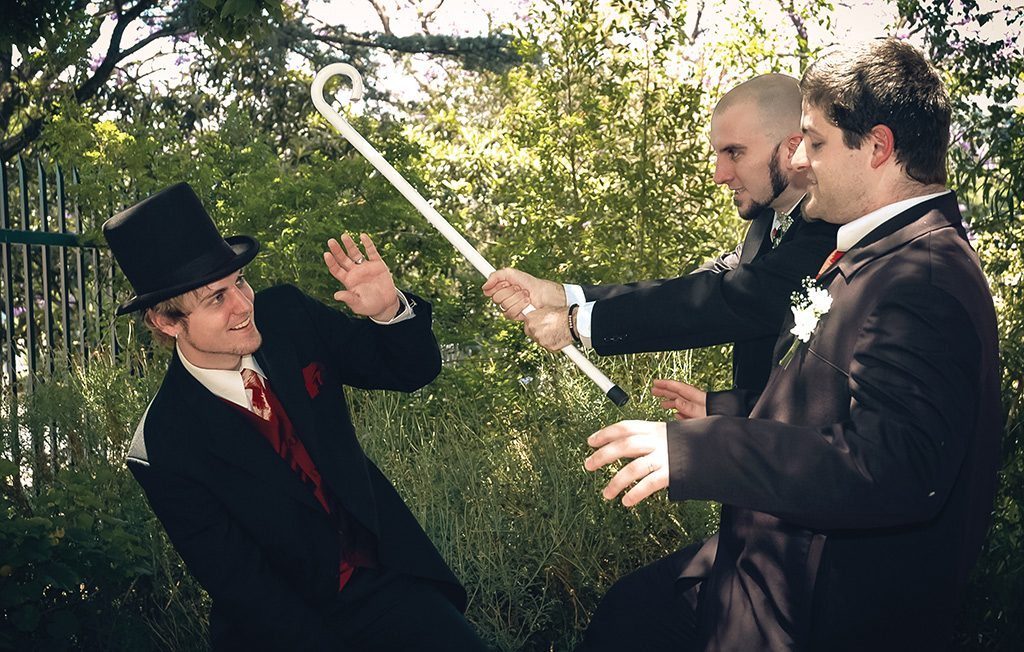 Wedding Photograph Groom getting caned