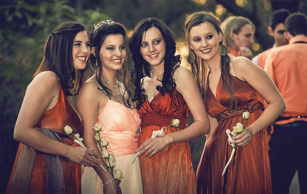 wedding photograph of bride, siblings and best friends